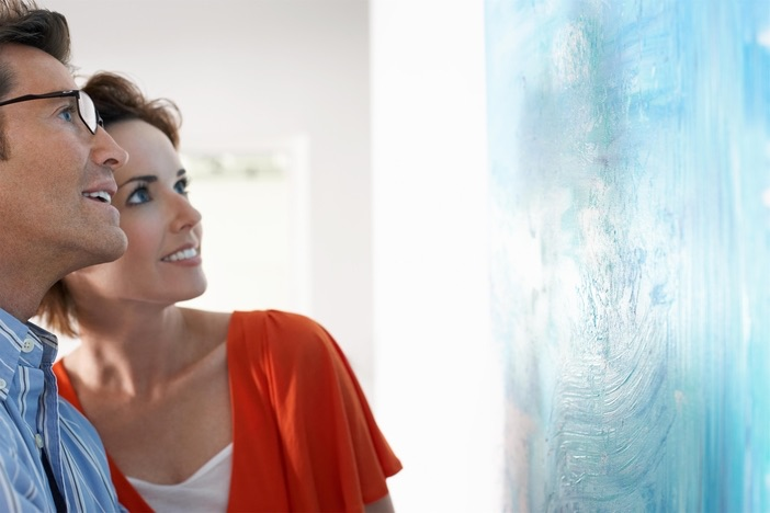 couple enamored with art exhibit