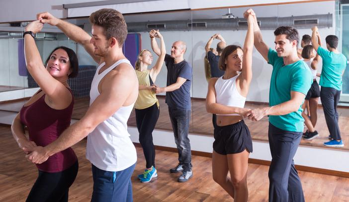 couples dancing in a studio