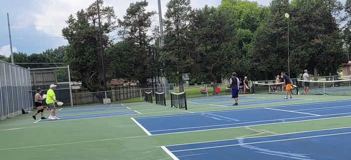 people playing pickleball at meador
